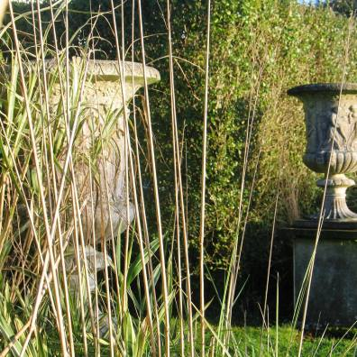 Fading winter grasses and classical urns