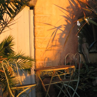 The rich glow of the sunset reflecting on the Apricot terraces wall