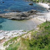 View to a secluded cove as the tide retreats