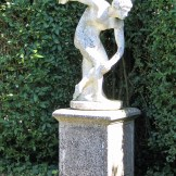 A statue of the discus thrower in the Italian Garden at Ednovean Farm