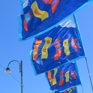 bright flags flying over Penzance promenade