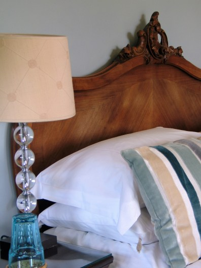 Chic glass lamps, velvet cushions and a lovley hand carved walnut french bed
