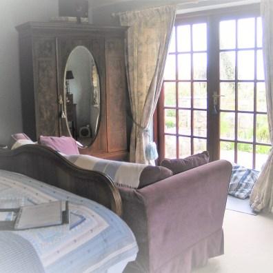 Fretnch doors to a private terrace in a B&B room at Ednovean Farm