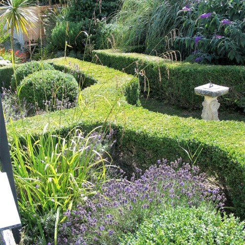 Formal box hedges framea sundial with enclosure full of lavender