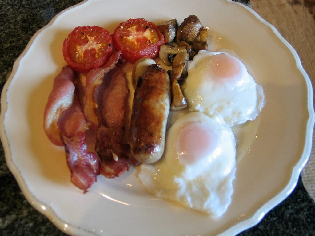 A full english breakfast with poached eggs, bacon, tomatoes and mushrooms served at Ednovean Farm