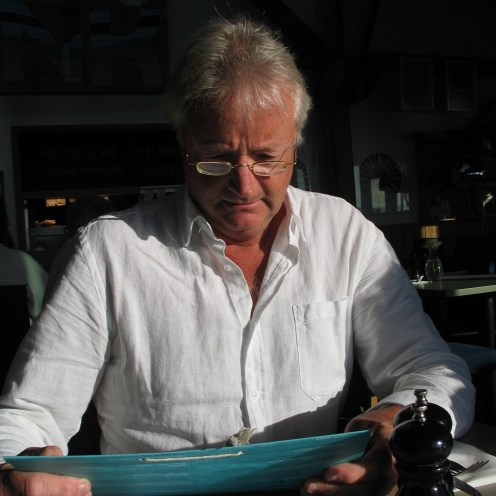 Charles studying the wine list