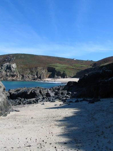 Silver white sands below rugged cornish cliffs