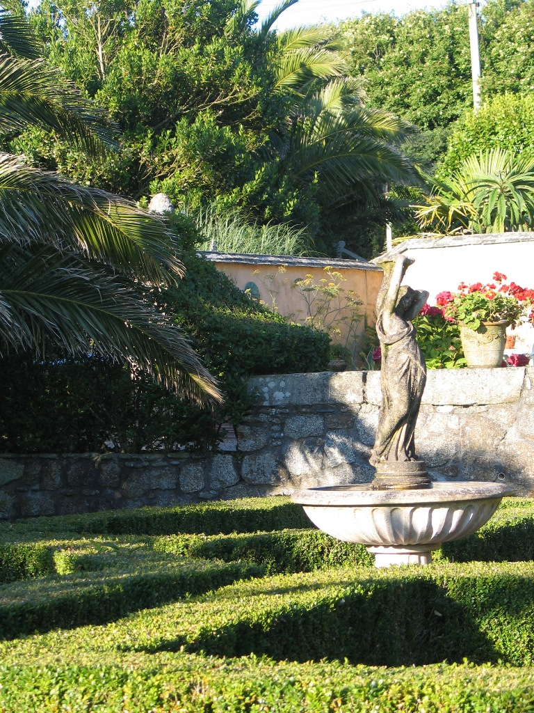 formal box hedges with fountain in the courtyard garden at Ednovean Farm