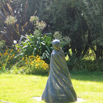 Asculpture on the lower lawn with califorian poppies