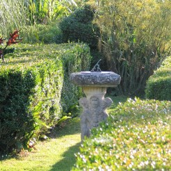 sundial surrounded by formal box hedges - ednovean farm garden