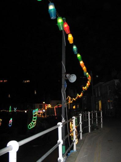 lanterns blowing inthe breeze above Mousehole harbour