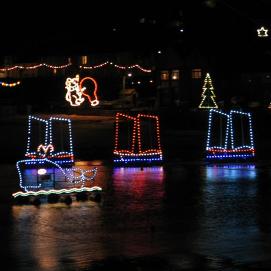 christmas lights whale and three ships mousehole harbour