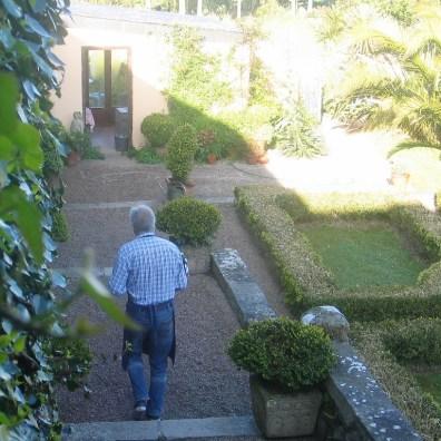 man carrying tray through courtyard