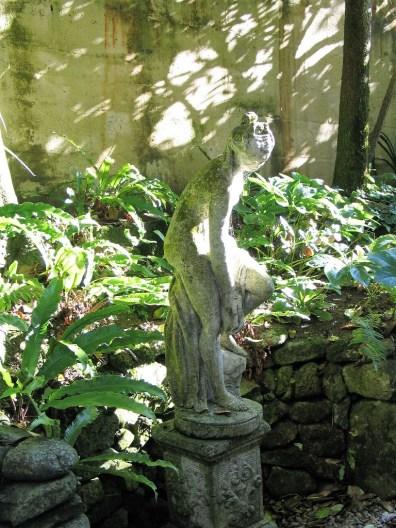 Dappled sunshine on statue