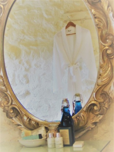 Bathrobe and reflected in silver mirror
