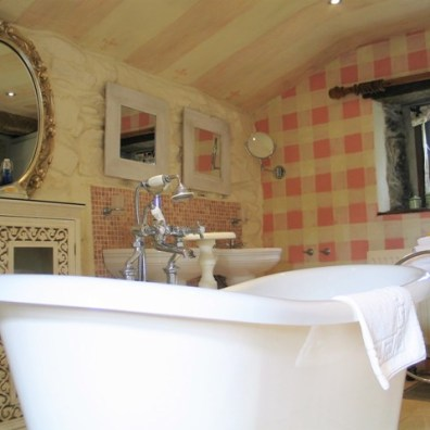 Central Bateau bath under stripped ceiling