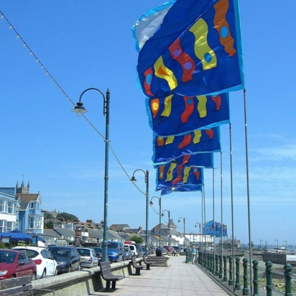 Bright silk flags flying above Penzance Promenade