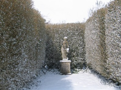 Statue in the snow - february's garden transformed