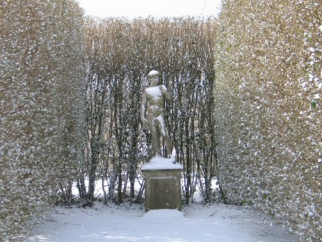 Formal statue in the snow - David
