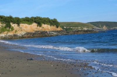 Waves breaking on sandy beach - perranuthnoe in the heatwave