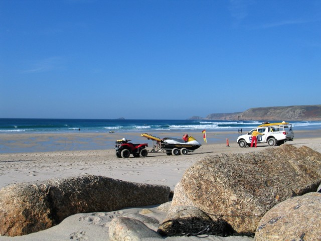 Lifegaurd vehicles on the broad sandy beach - Sennen in the Autumn