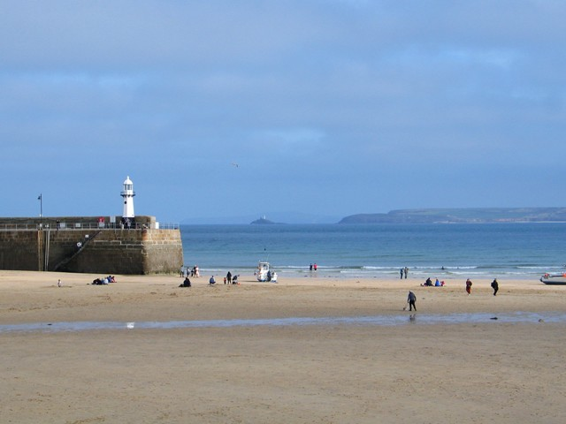 Empty harbour and twoin lighthouses - view from St Ives