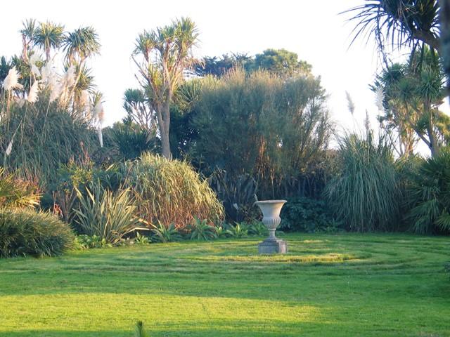 Lawn and urn - golden autumn garden November