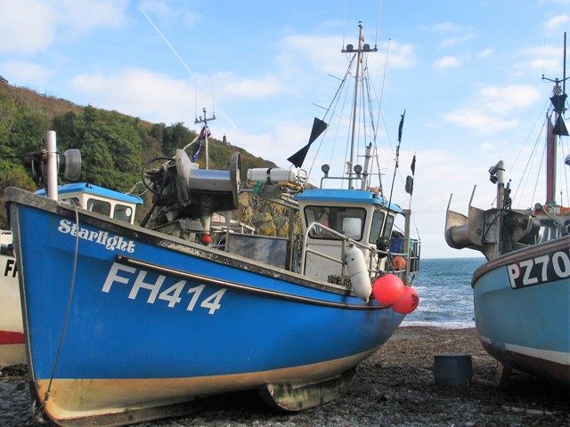 Blue fishing boat in sheltered cove - Cadgwith