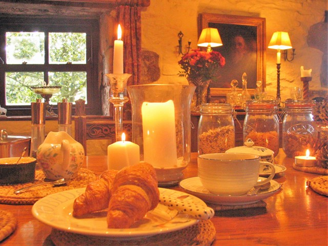 croissants and candles - autumn breakfast table