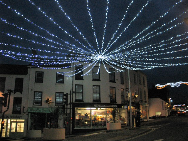 A great cobweb of Christma lights spans teh first junction in Penzance