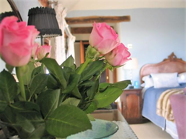 Fresh roses in a luxury vintage bedroom