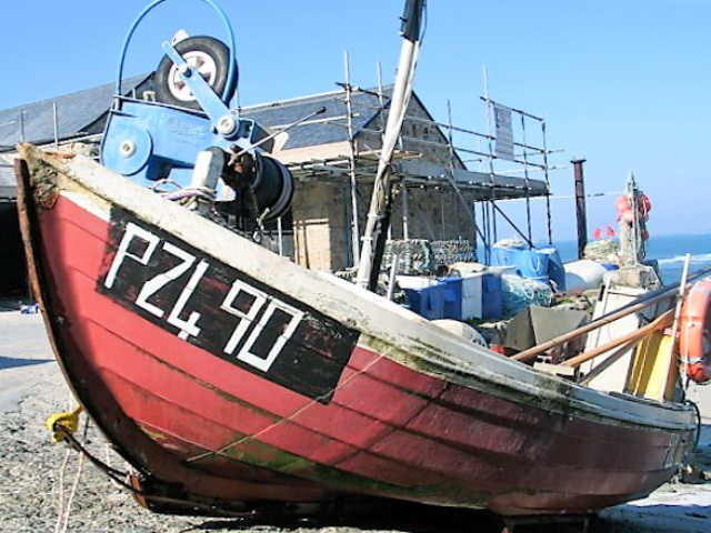 Old fishing red boat on slipway