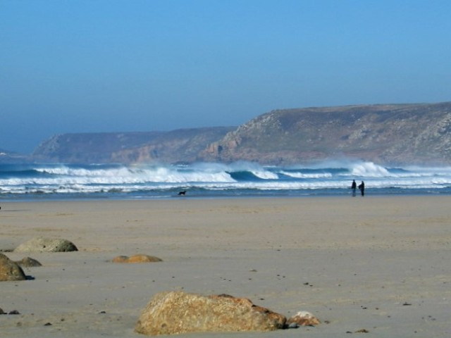 distant surf on sandy beach at low tide - Sennen