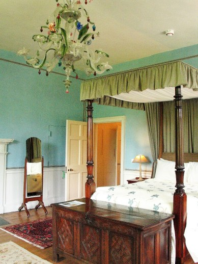 Stylish master bedroom with four poster bed