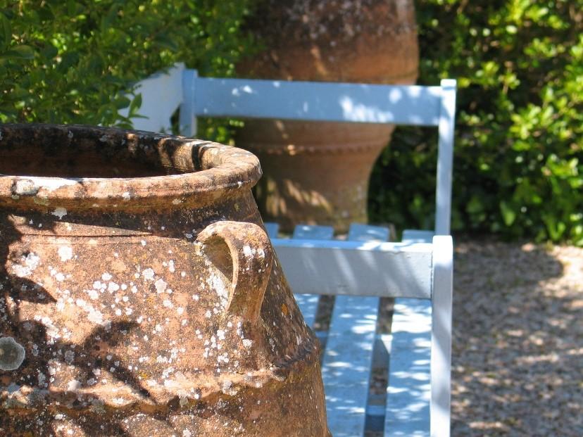 Greek pots flanking blue bench
