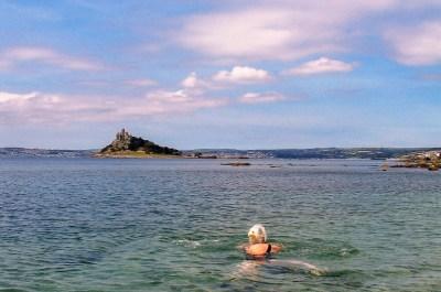 swimming in clear seas below St Michael's Mount