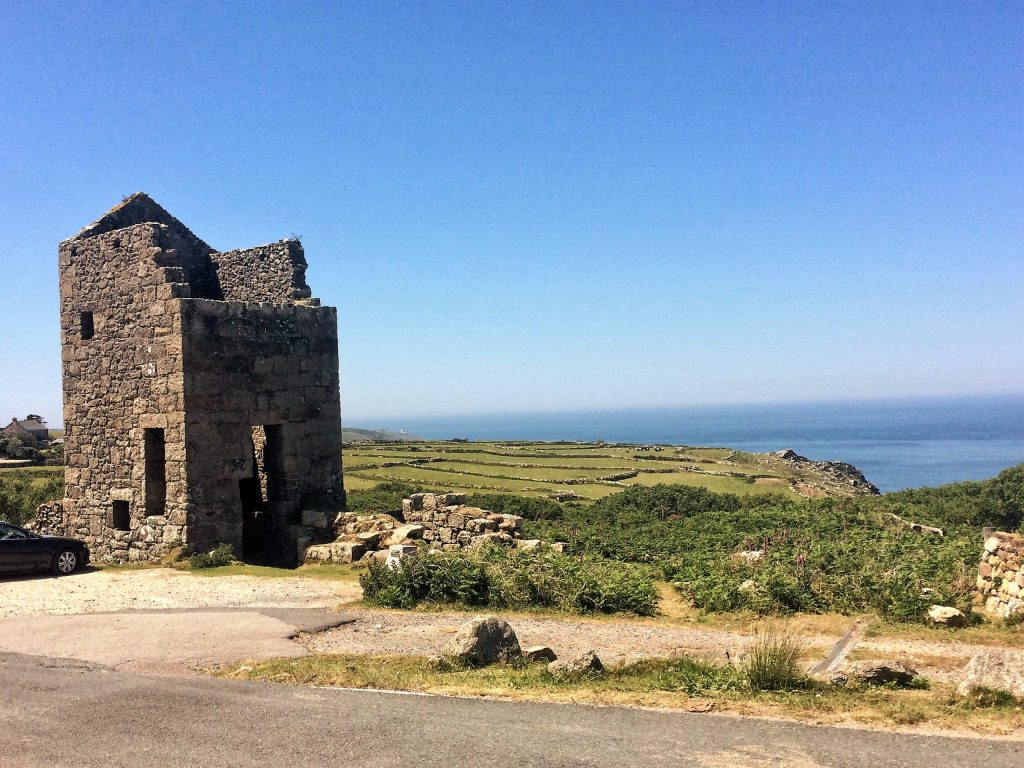 Carn Galva ruined engine house with ancient field systems above the sea