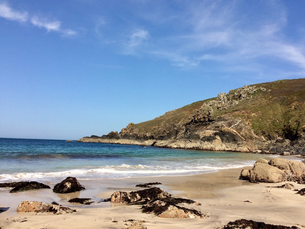 Porthmeor Cove -isolated sandy beach at low tide in West Corwnall