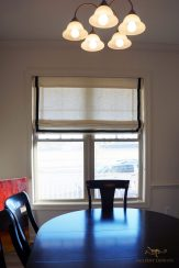 lined roman shades with accent banding around edges