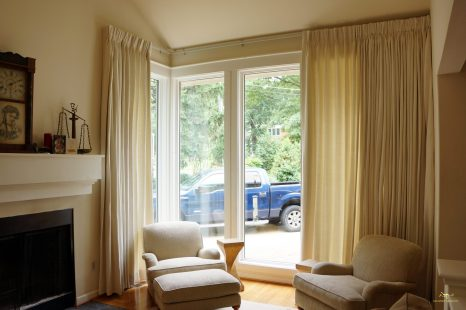 Pinch pleated panels on motorized rods for privacy and light control