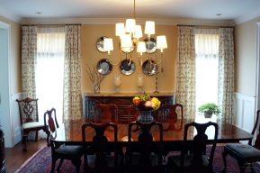 "Pinch pleated panels on 1/2"" metal rod with full function for a traditional dining room."