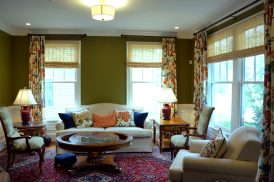 Lined side panels with bright floral pattern for the living room