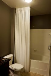 White Shower Curtain with ceiling mounted rod