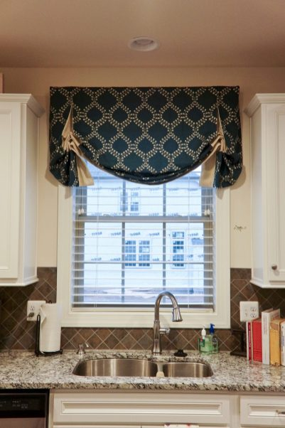 Shaped valance with contrast inserts