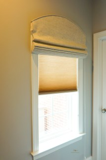 Room darkend roman shades with an arch top