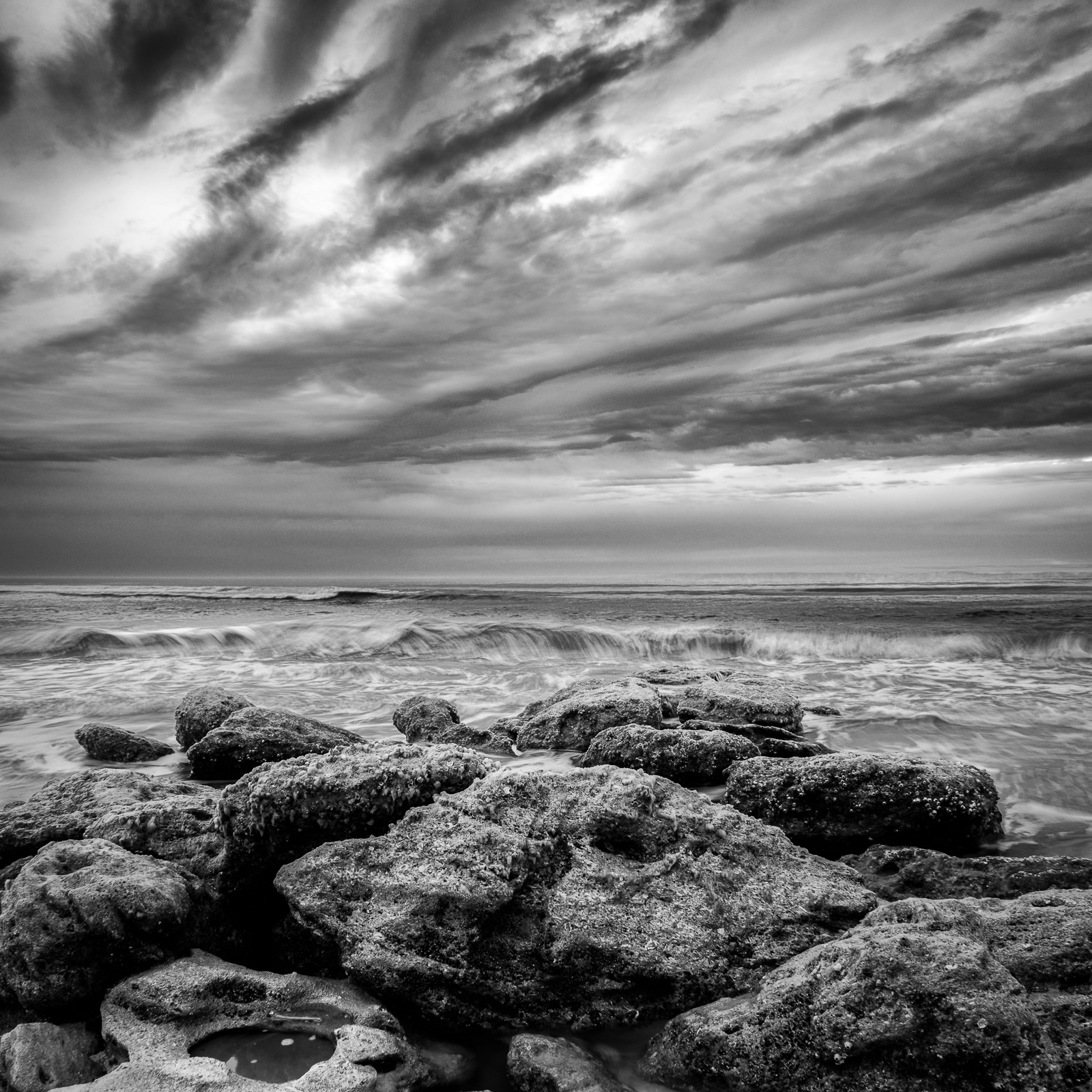 Clouds, waves, and rocks: Marineland Beach
