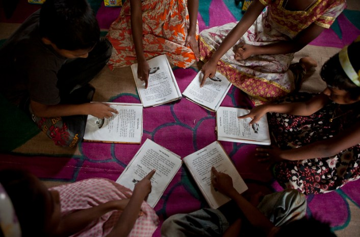 Children take part in an exercise in groups inside a BRAC primary school in Manikganj.