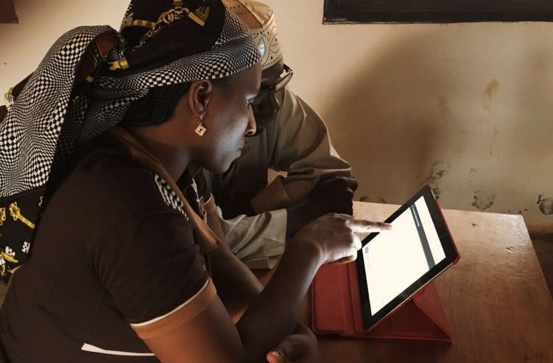 A man and woman using a laptop