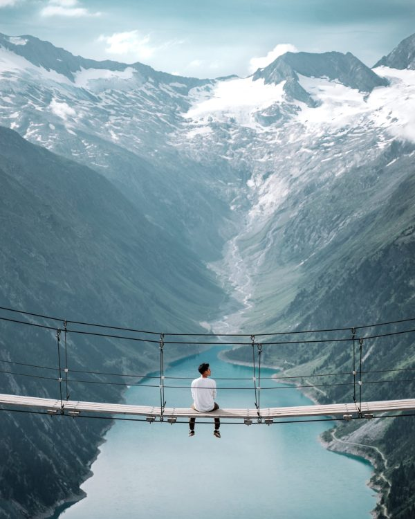 person enjoying the view from a bridge
