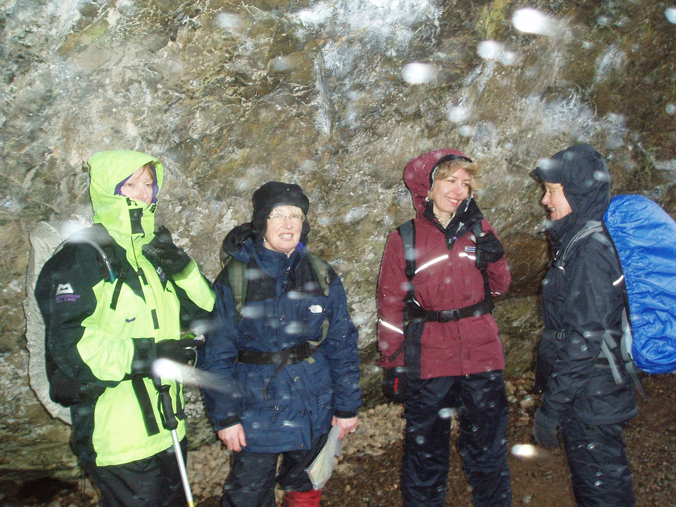 sheltering from pouring rain under the Bowder Stone.JPG